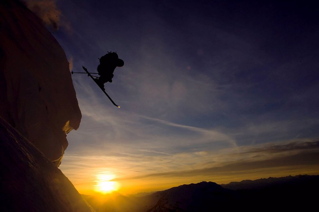 Skiier jumps cliff at twilight Whistler, BC, Canada : Stock Photo