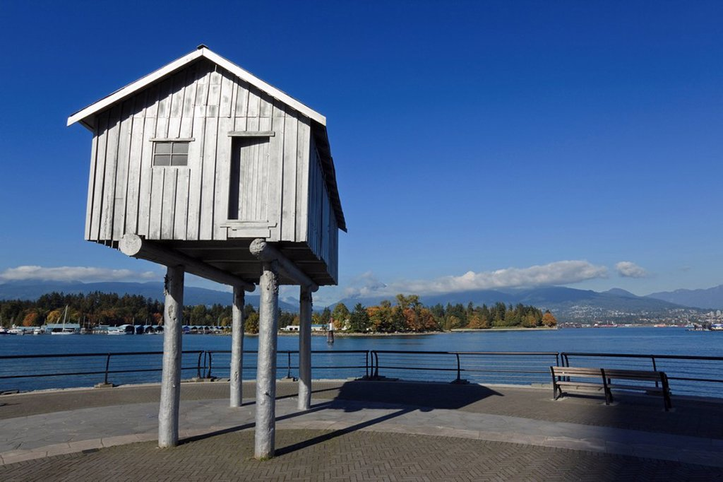 Stock Photo: 1990-32886 The Light Shed by artist Liz Magor is a half size aluminum replica of the original wooden freight shed on the Vancouver City Wharf in Coal Harbour overlooking Coal Harbour along the Seawall in front of Harbour Green Park, Vancouver British Columbia Canada