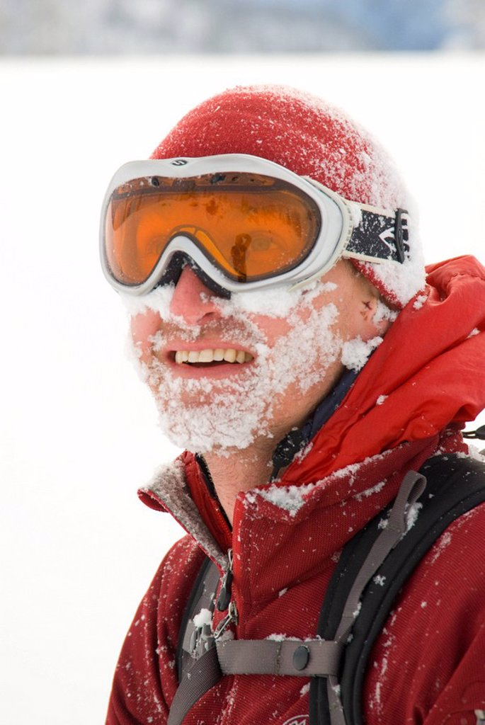 A male skier has a face full of snow, Monashee Mountains, British Columbia : Stock Photo