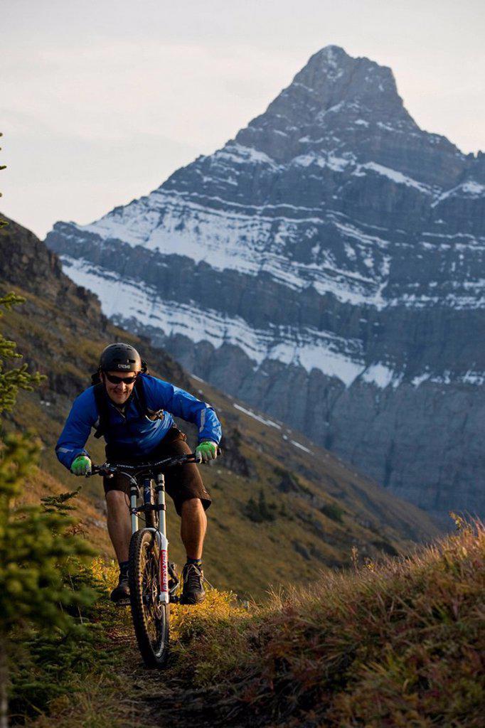 A mountain biker rides in Kananaskis, AB : Stock Photo