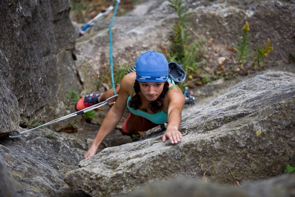 A 13 year old girl does one of first gear leads, Boa 5.3, Rattle Snake Point, ON : Stock Photo
