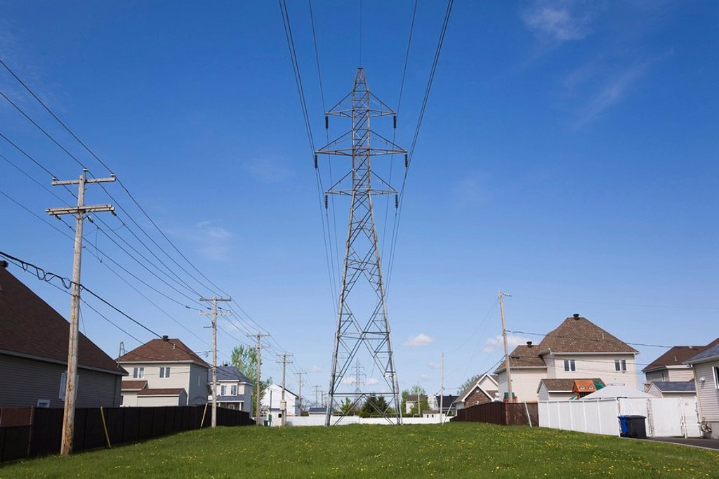 Residential Homes and Hydro Electricity transmission towers in a Suburb, Lachenaie, Quebec, Canada : Stock Photo