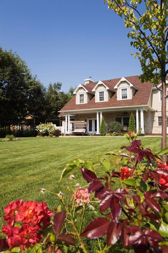 Landscaped backyard with Modern style Canadiana Residential Home, Laval, Quebec, Canada. This image is property released. PR0069 : Stock Photo