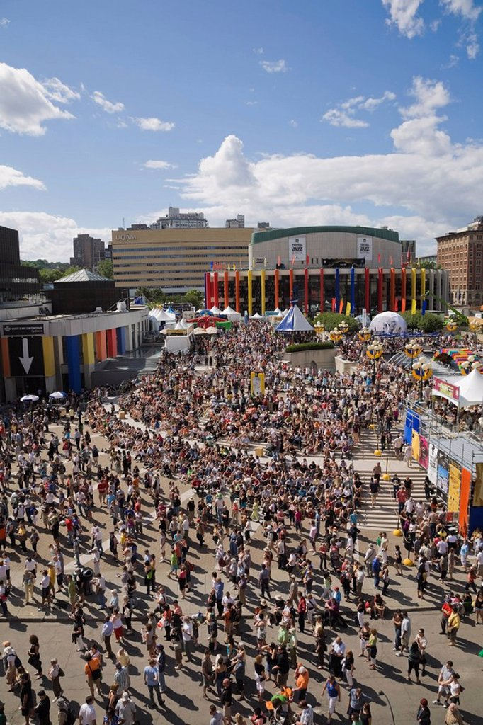 High angle view of the Crowd of Tourists and Locals attending the Montreal International Jazz Festival activities outdoors around Place des Arts in the Summertime, Montreal, Quebec, Canada : Stock Photo