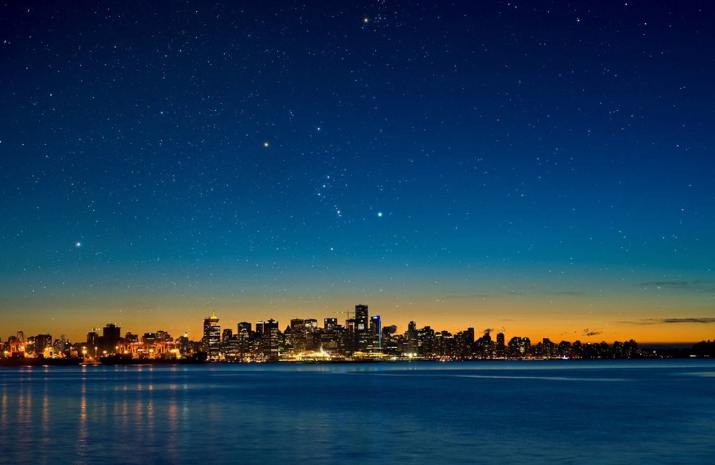 The constellation Orion setting over Vancouver skyline. : Stock Photo