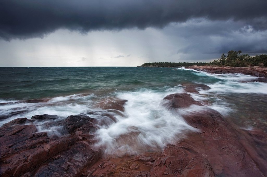 Waves crash to shore from Georgian Bay as a storm approaches Killarney Provincial Park in Norther Ontario. : Stock Photo