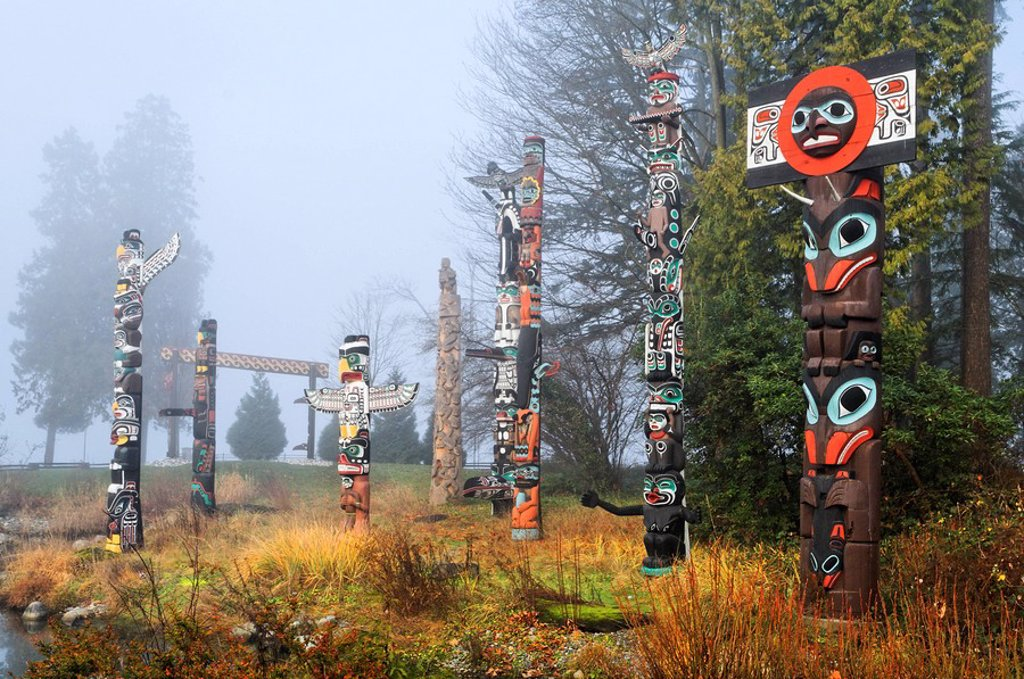 West Coast First Nations totem poles at Totem Park, Brockton Point, Stanley Park, Vancouver, British Columbia : Stock Photo