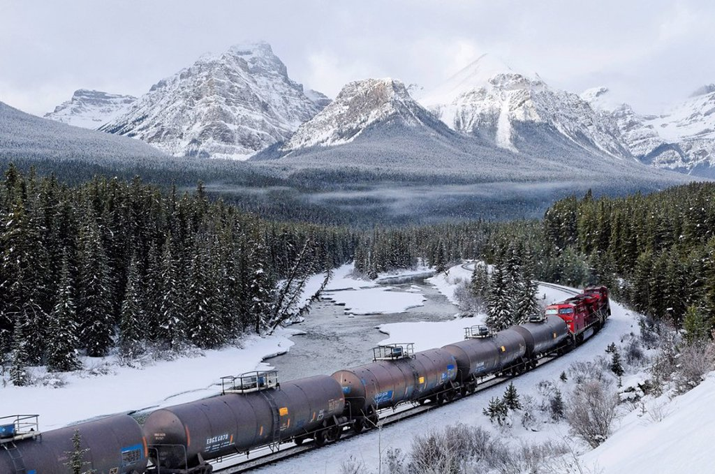 Stock Photo: 1990-35141 Train at Morant´s curve with Haddo Peak, Saddle Mountain, Fairview Mountain in the background, Banff National Park, Alberta, Canada