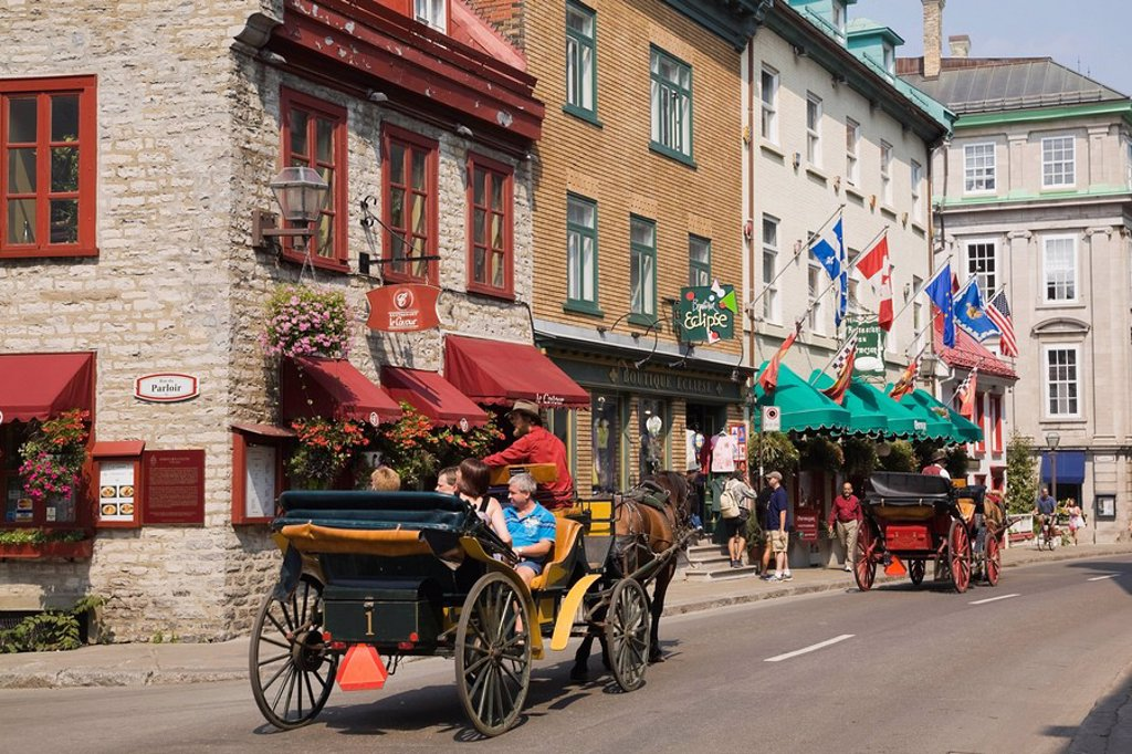 Stock Photo: 1990-35152 Tourists riding in Horse_Drawn Carriages Caleches along Rue Saint_Louis in the Upper Town area of Old Quebec City, Quebec, Canada