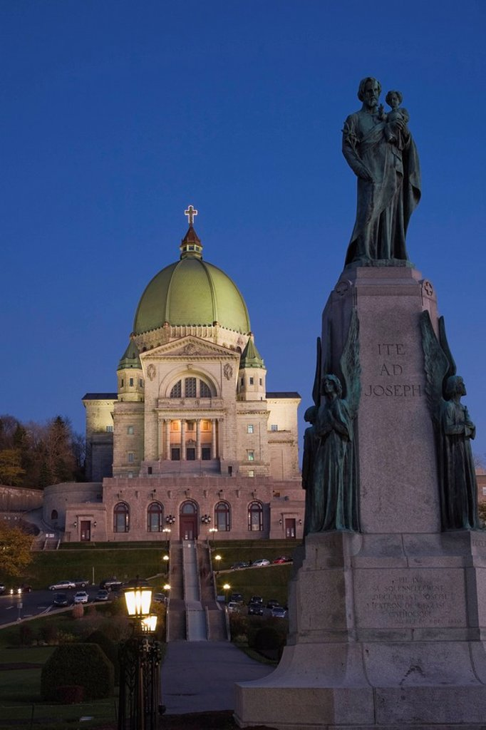 Stock Photo: 1990-35170 Religious Statue and Saint_Joseph´s Oratory at Dusk, Montreal, Quebec, Canada
