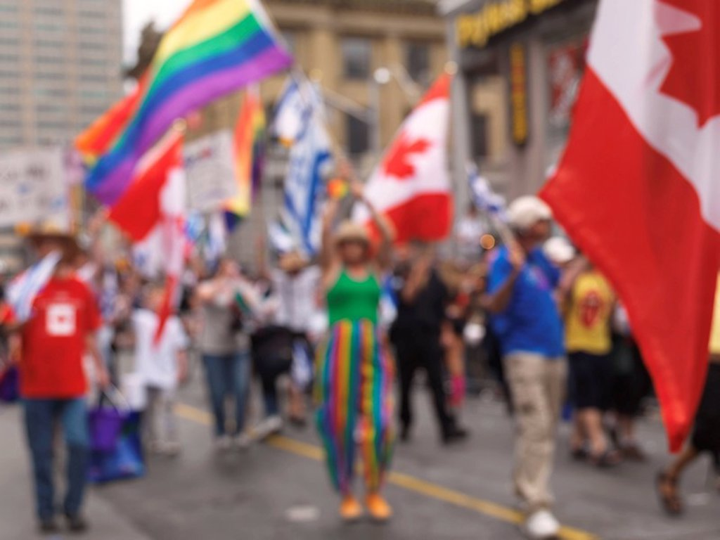 Out of focus photo of participants of Gay and lesbian Pride parade in Toronto Ontario Canada 2009 : Stock Photo