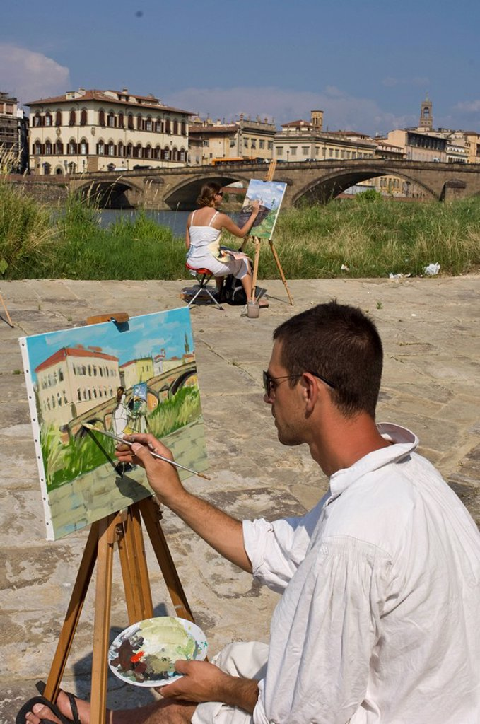 Art students paint by the Arno River, Florence, Tuscany, Italy : Stock Photo