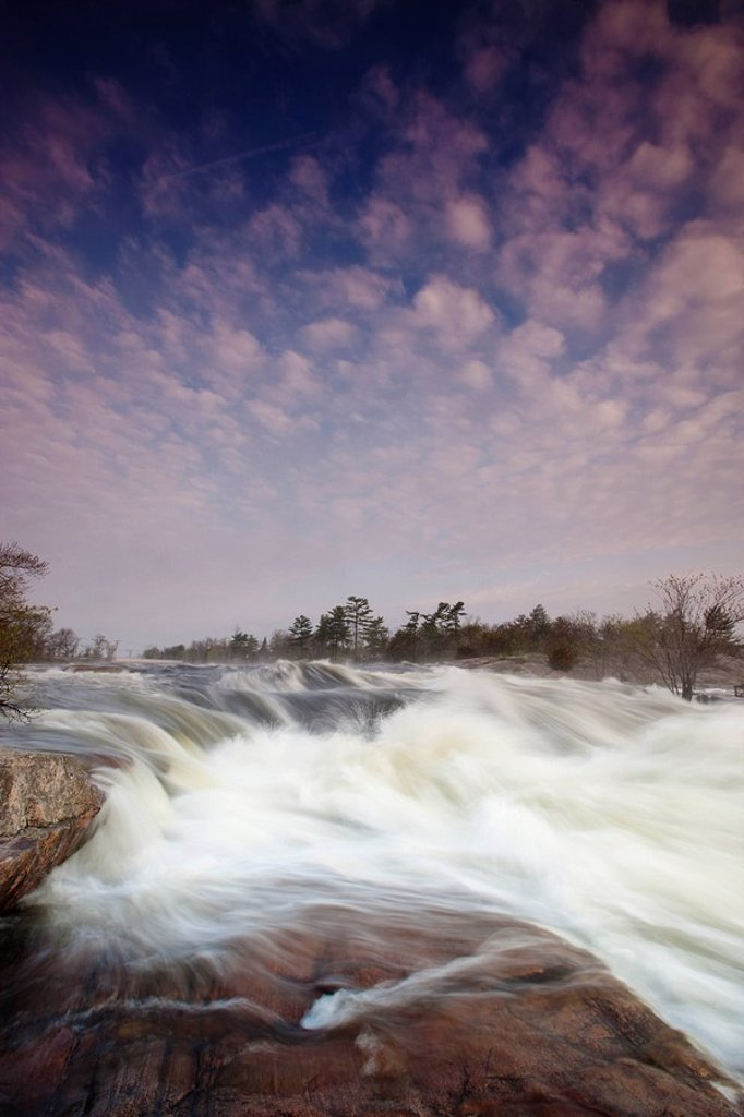 Stock Photo: 1990-36317 In 2009 a wet spring raised the water levels of the Otonabee River and Burleigh Falls, a cascade class waterfall in Peterborough County, Ontario, Canada became more rapid than usual