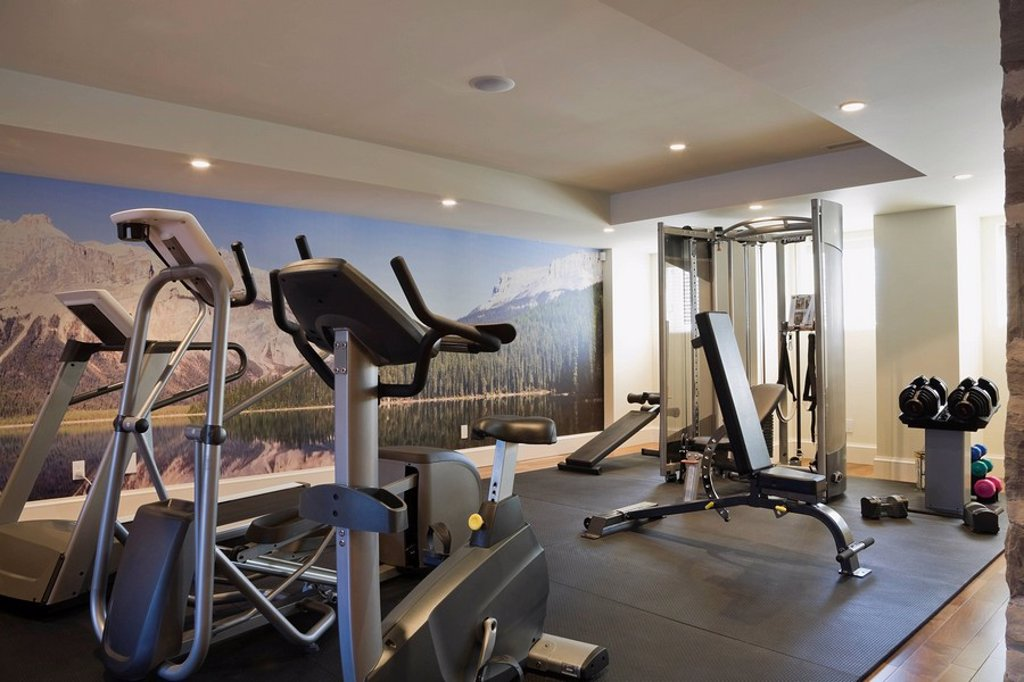 Stock Photo: 1990-36455 Basement Exercise Room with Fitness Equipment in a Residential Home interior.