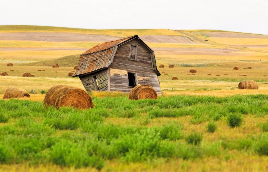 Stock Photo: 1990-36808 Twisted Barn on the Canadian Prairie, near the Big Muddy Badlands, Saskatchewan, Canada.