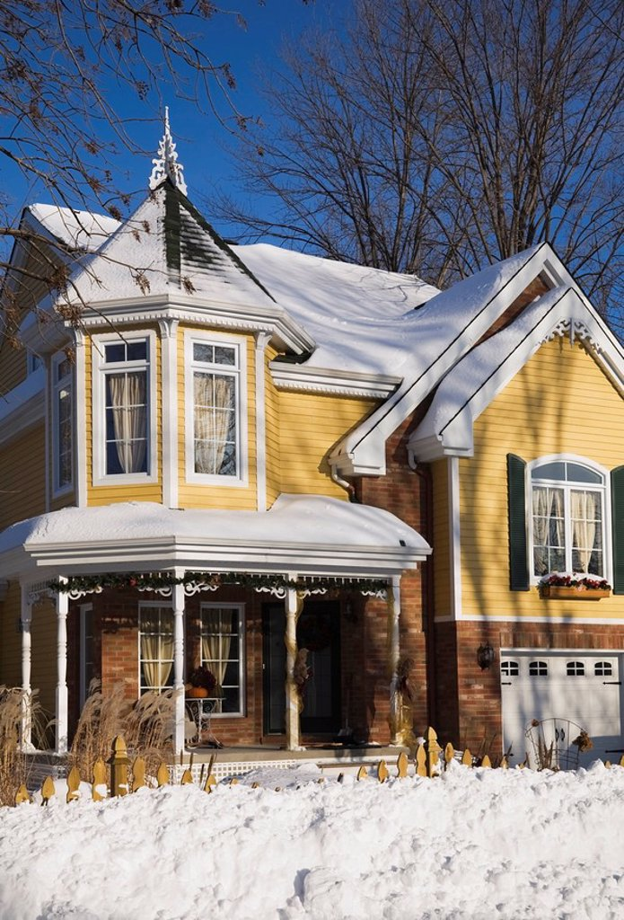Two_storied Victorian style residential home in winter, Laval, Quebec, Canada. : Stock Photo