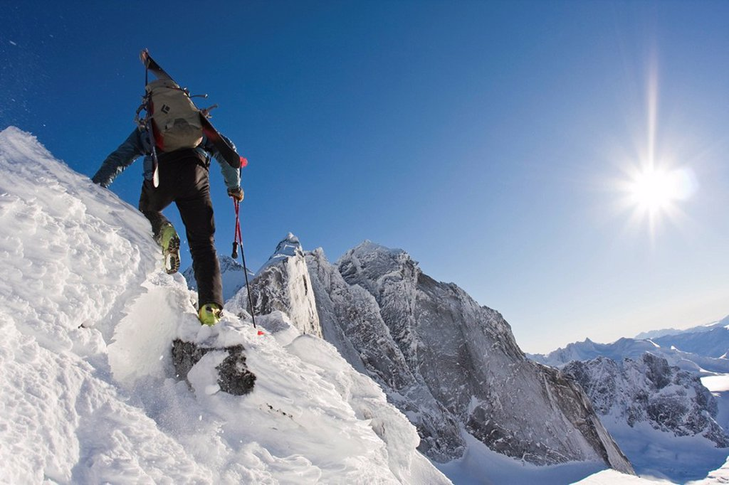 Stock Photo: 1990-37025 A backcountry skier hikes along an alpine ridge in Fairy Meadows, Adamant Range, Selkirks, BC