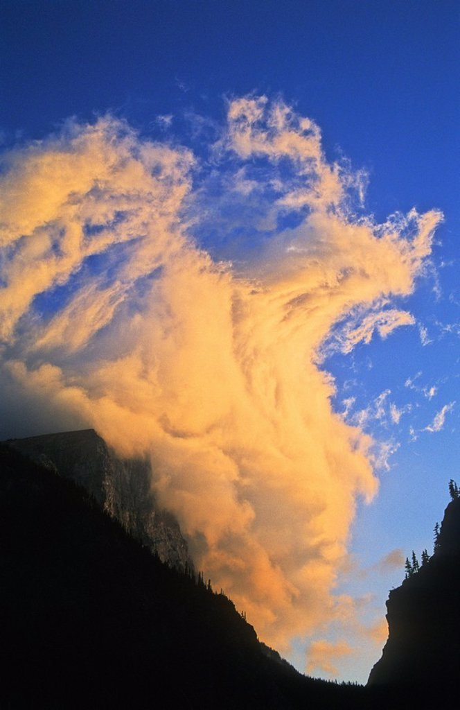 Dramatic storm cloud at sunset over Spray Gap, near Canmore, Alberta in the Canadian Rocky Mountains : Stock Photo