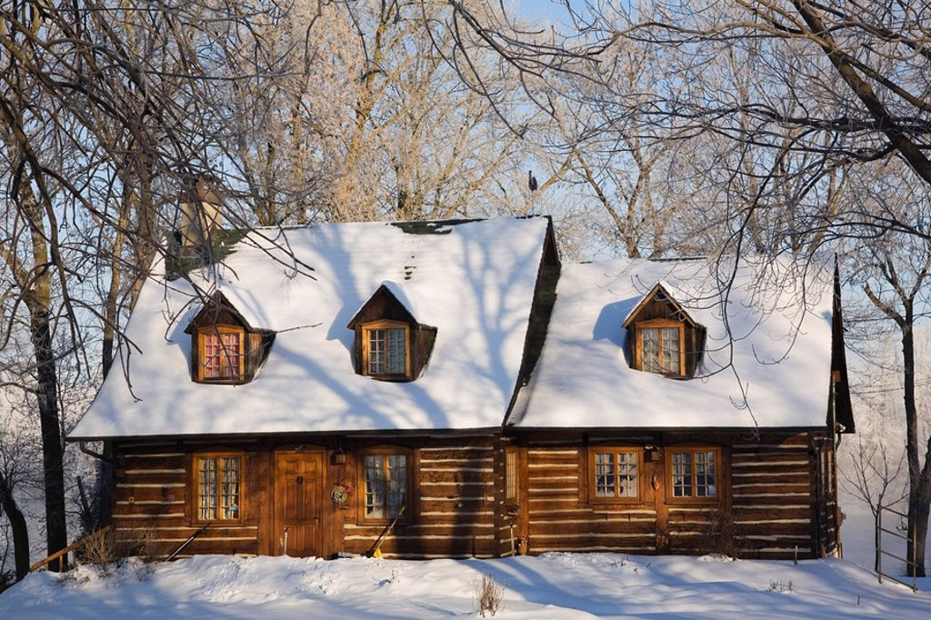 Stock Photo: 1990-37333 Two_story Canadiana style residential home through frost covered trees in winter, Laval, Quebec, Canada.