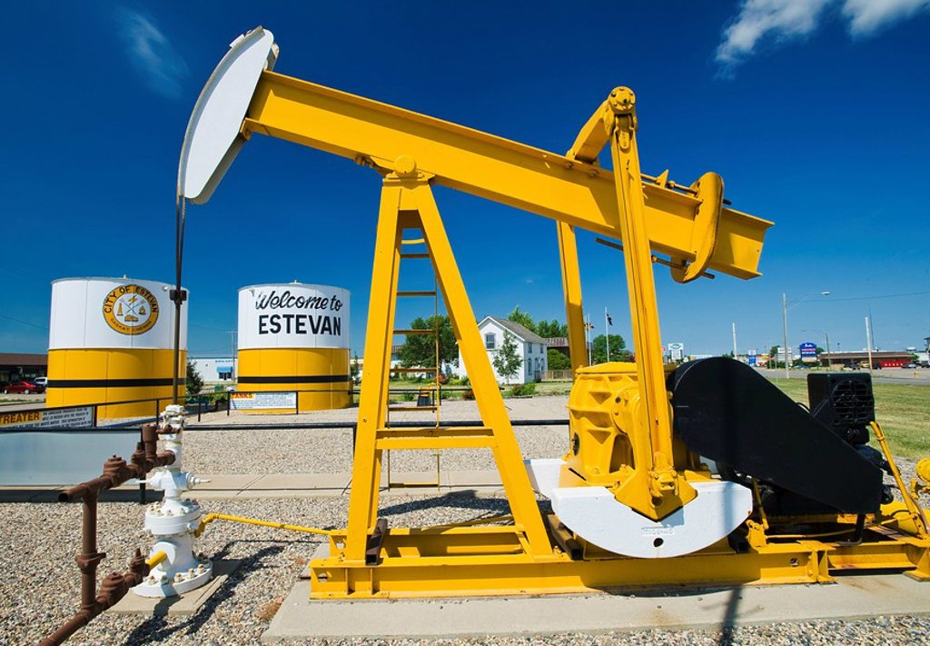 pumpjack and oil storage tank, Estevan, Saskatchewan, Canada : Stock Photo