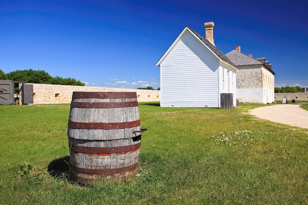 Whiskey barrel and historic buildings of Lower Fort Garry National Historic Site, Manitoba, Canada. : Stock Photo