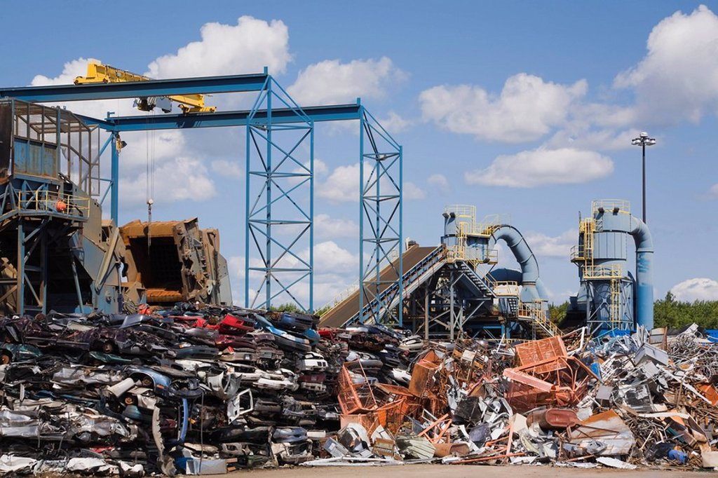 Stacked and Crushed Automobiles and Industrial Metal Shredder at a Scrap Metal Recycling Junkyard, Quebec, Canada : Stock Photo