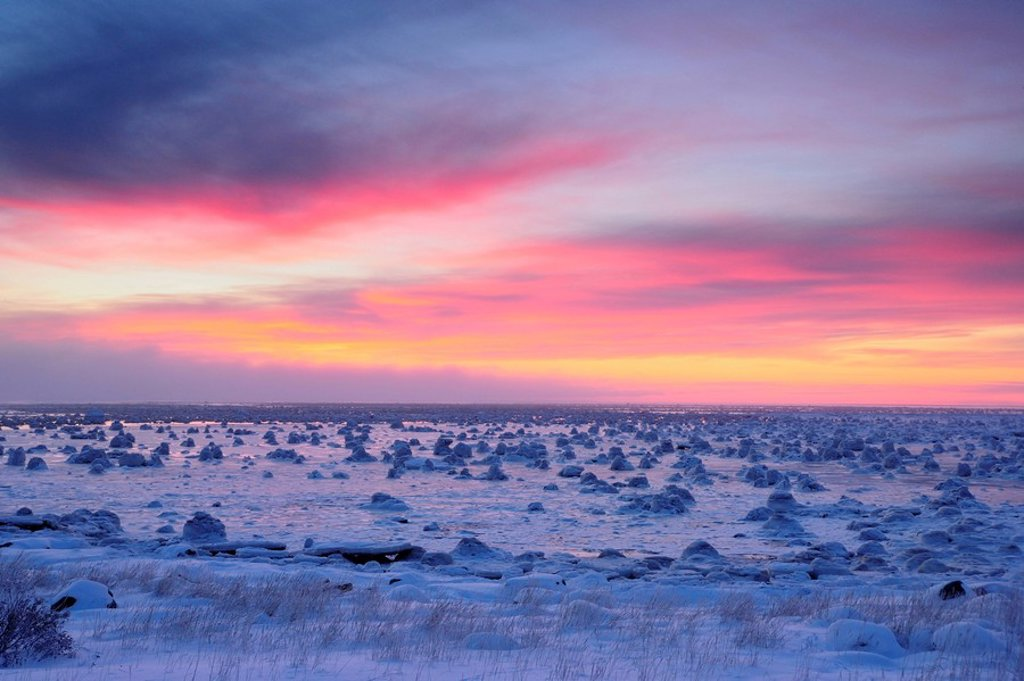 Sunrise skies over Hudson Bay in early winter. Seal River Heritage Lodge, Churchill, Manitoba, Canada. : Stock Photo