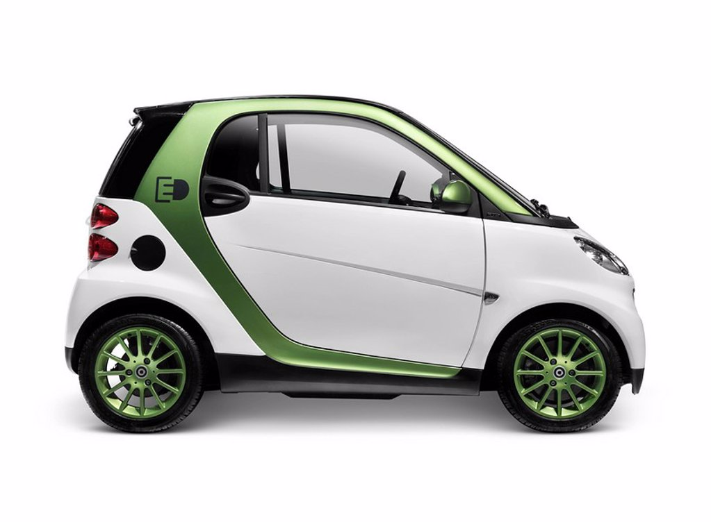2010 Smart Fortwo Electric Drive _ eSmart _ Smart ED battery powered city car. Isolated on white background with clipping path. : Stock Photo