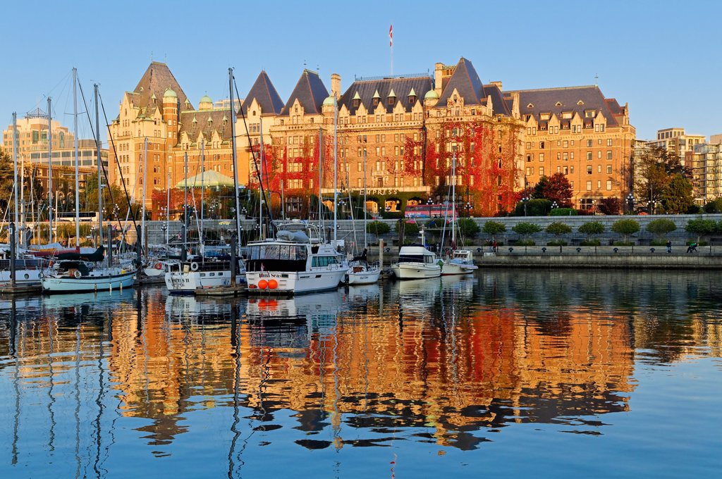 The Empress Hotel reflected in the Inner Harbour, Victoria, British Columbia, Canada : Stock Photo