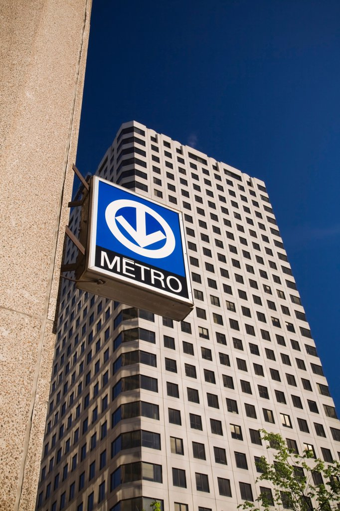 Downtown Montreal Subway Metro Station Sign attached to the side of a Building in Downtown Montreal, Quebec, Canada : Stock Photo