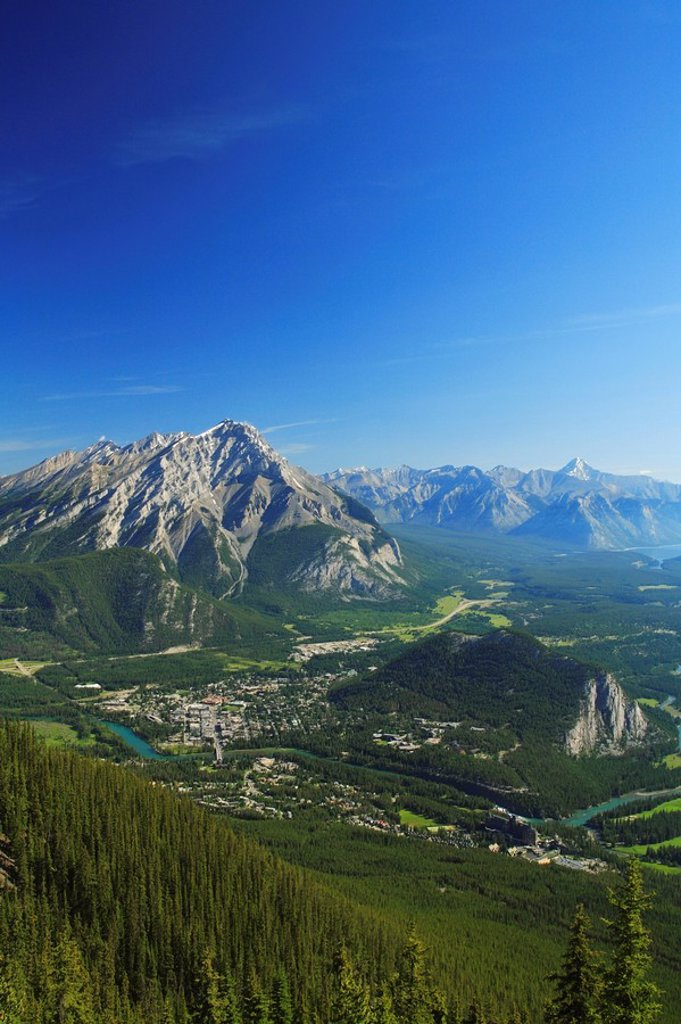 Aerial view from the top of Sulphur Mountain of the Town of Banff and Cascade Mountain, part of the Banff-Jasper World Heritage Site, Banff National Park, Alberta, Canada : Stock Photo