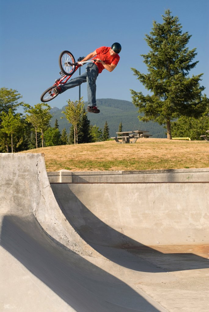 BMXer with a can_can air on the quarter at Lafarge Skatepark, Coquitlam, BC, Canada. : Stock Photo