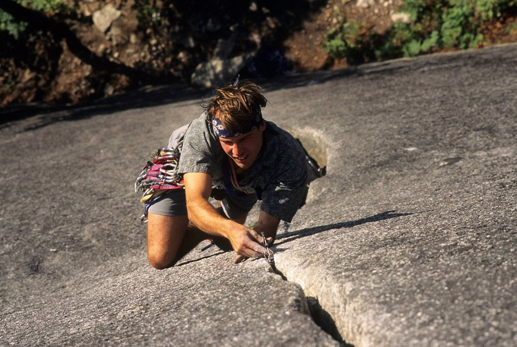 Stock Photo: 1990-4375 Climber on Seasoned in the Sun, Base of the Grand Wall, Stawamus Chief, Squamish, British Columbia, Canada