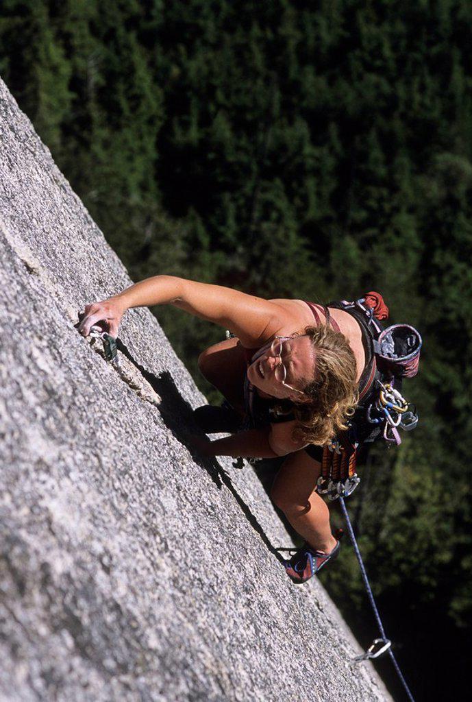 Stock Photo: 1990-4382 Woman climbing Sunblessed, 5 10, The Solarium, Stawamus Chief, Squamish, British Columbia, Canada
