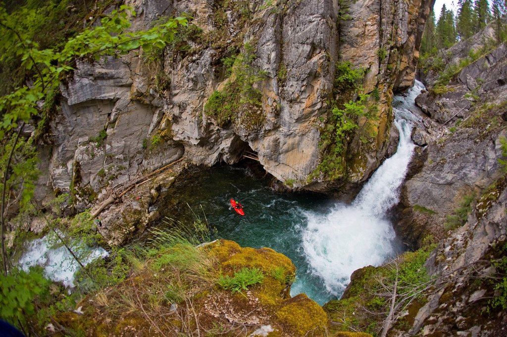 A male kayakers drops a 30 ft waterfall on Sand Creek, Galloway, British Columbia, Canada : Stock Photo