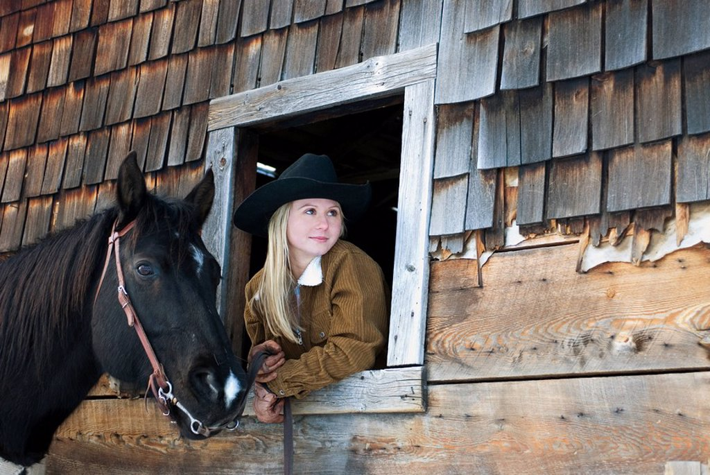 Cowgirl and her horse, Kamloops, British Columbia, Canada : Stock Photo
