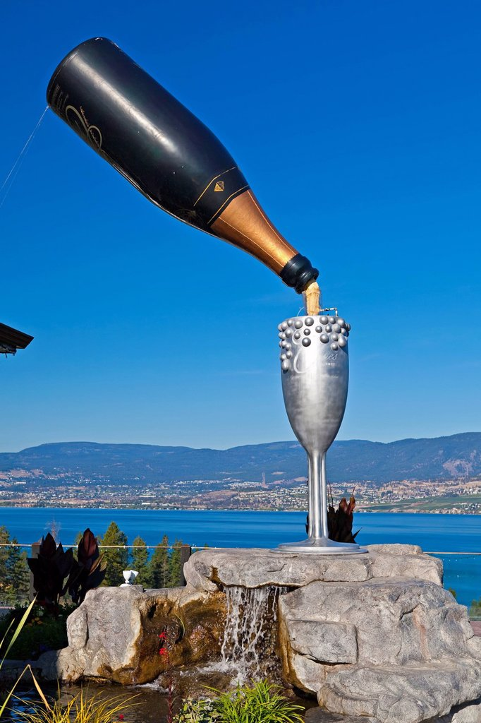 Stock Photo: 1990-45275 Large bottle of sparkling wine and goblet in the Summerhill World Peace Park at the Summerhill Pyramid Winery, a certified organic vineyard, Kelowna, Okanagan, British Columbia, Canada.