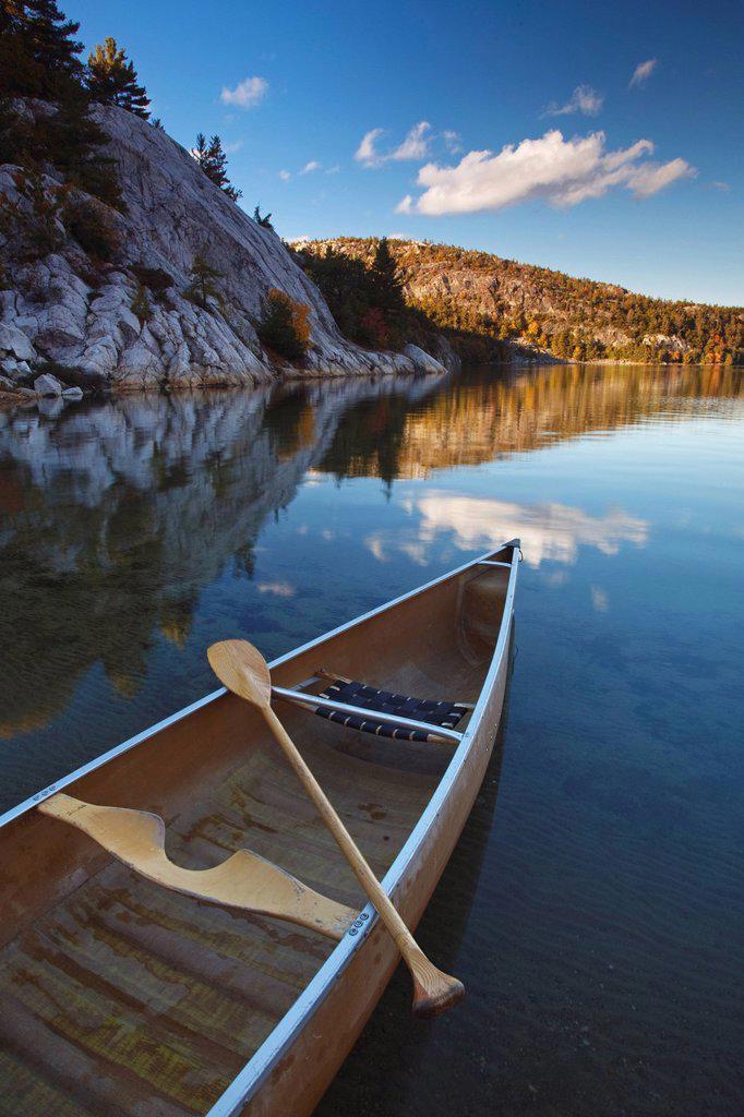 Sunset, Canoe on George Lake in Killarney Provincial Park, Ontario, Canada. : Stock Photo