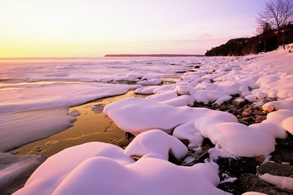 Stock Photo: 1990-4610 The sun rises over the snowy Georgian Bay shoreline in winter, at Dyers Bay, Bruce Peninsula, Ontario, Canada