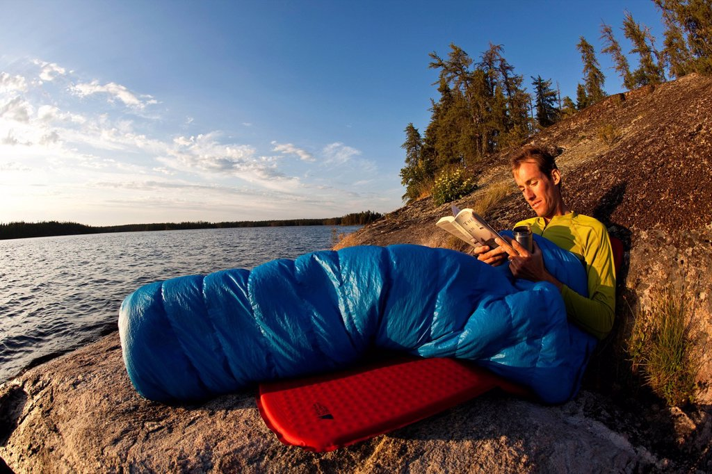 A young man camping for 2 weeks in Wabakimi Provincial Park, Northern Ontario, Canada : Stock Photo