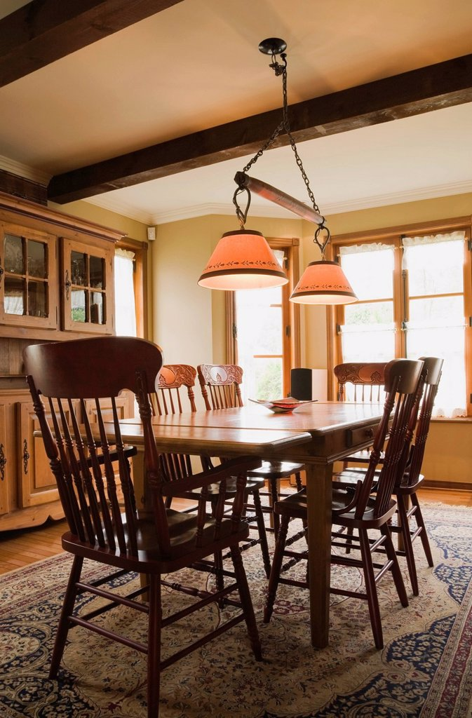Antique table, chairs and dresser with furnishings in the dining room of a 1998 Reproduction of an Old Canadiana cottage style Residential Home, Quebec, Canada. : Stock Photo