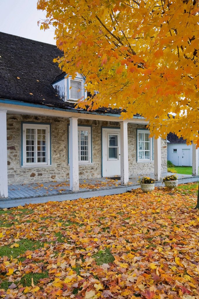 Old Canadiana circa 1781 cottage style fieldstone Residential Home in autumn, Quebec, Canada. : Stock Photo