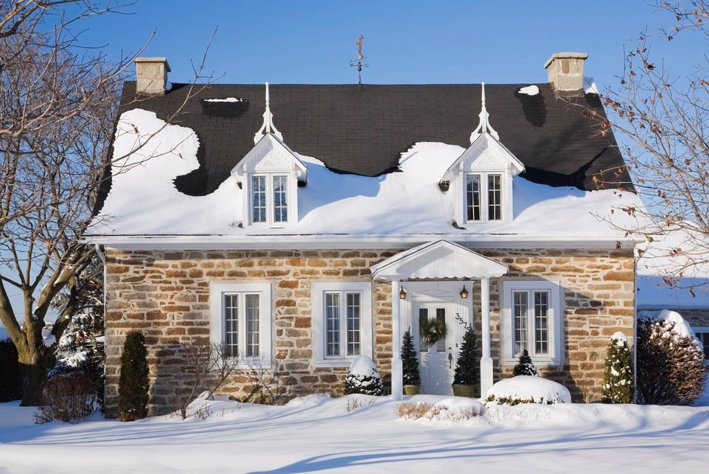 Stock Photo: 1990-46394 Old Canadiana Fieldstone Cottage style Residential Home in Winter, Quebec, Canada.
