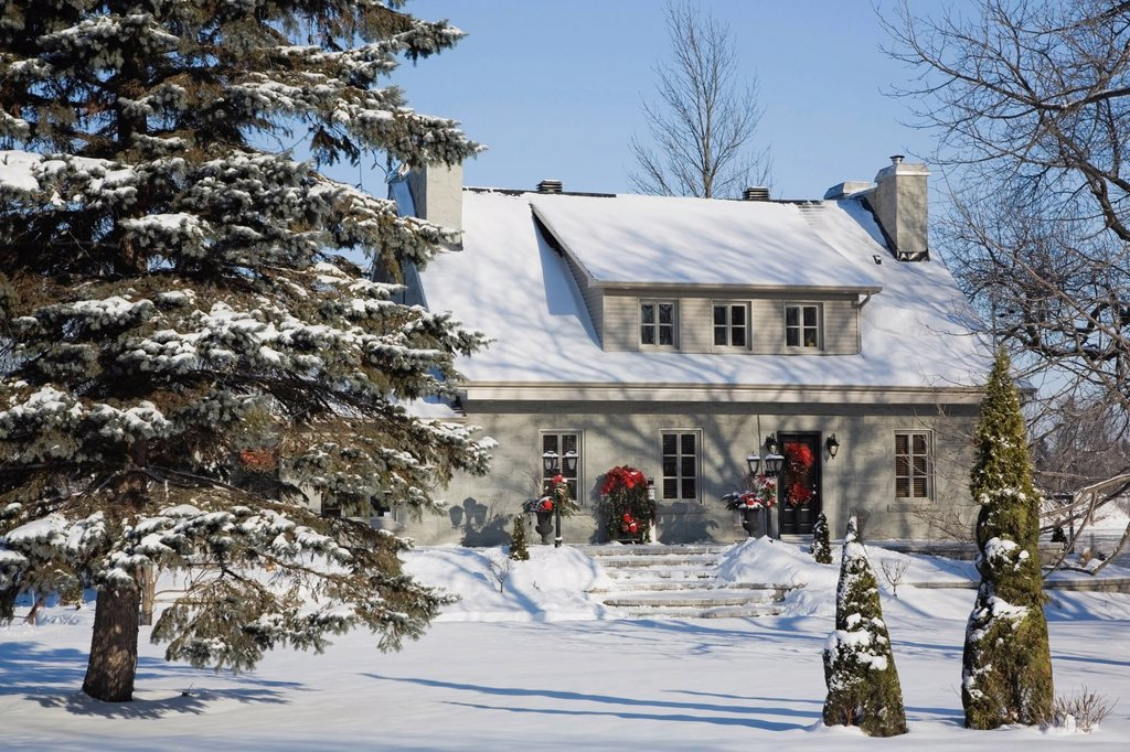 Residential home with Christmas decorations in winter, Quebec, Canada. : Stock Photo