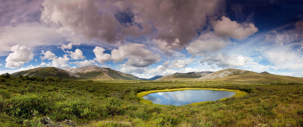 Pond and hills along the Dempster Highway in the Yukon, Canada : Stock Photo
