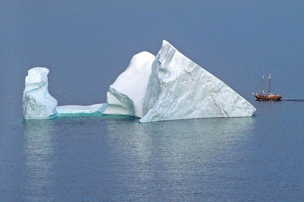 Iceberg and sailing ship off St  John´s Newfoundland, Canada : Stock Photo