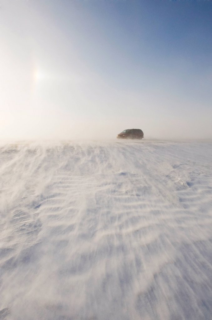 Road covered with blowing snow, near Morris, Manitoba, Canada : Stock Photo