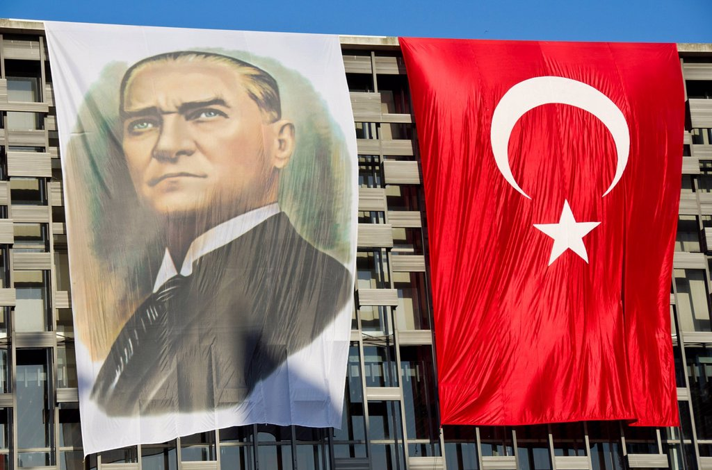 Stock Photo: 1990-49343 Portrait of Mustafa Kemal Atatürk and Turkish Flags on the Atatürk Cultural Center, Istanbul, Turkey