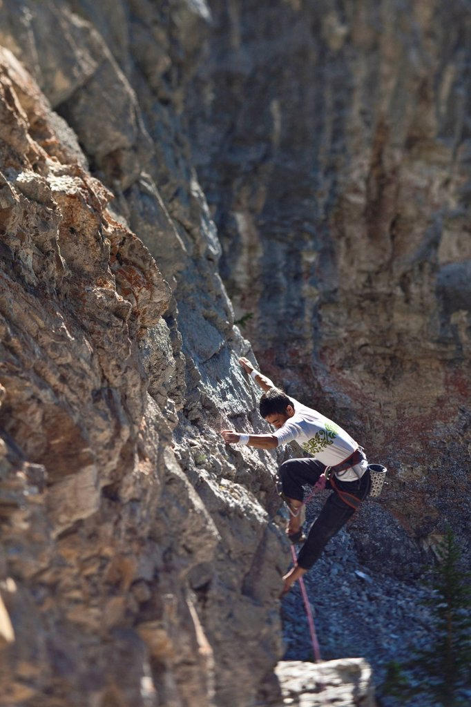 A male rockclimber climbing at Echo Canyon, Canmore, Alberta, Canada : Stock Photo