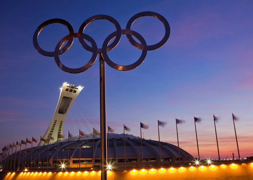 Olympic Stadium, designed by Architect Roger Taillibert, illuminated at dawn, Montreal, Quebec, Canada : Stock Photo